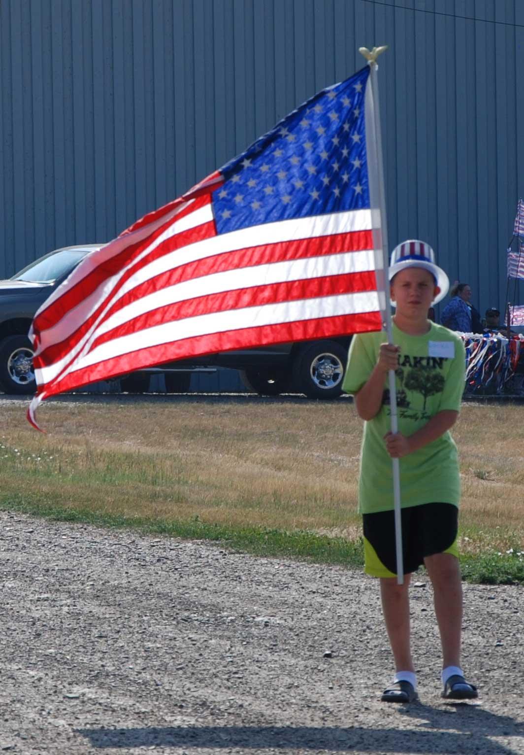 Boy-with-backlit-flag-w