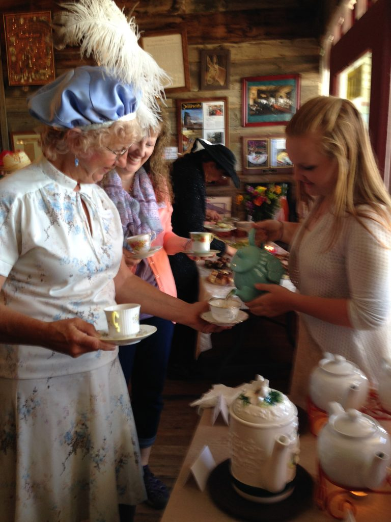 2016 Tea Cherie Heser of Forsyth having tea poured_Jersey Lilly_6073-aif